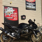 Exterior of Mad Brothers Cycles motorcycle shop with street bike out front