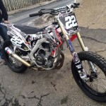 Customized motocross bike with large exhaust
