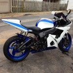 Custom painted street bike with white and blue accents
