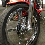 Closeup of chrome plating on wheels and suspension