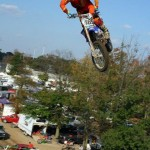 Rider high in the air doing motocross stunt