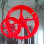 Motorcycle wheels on drying rack after powder coating
