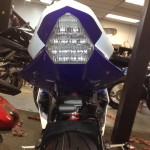 Front headlight of motorcycle after being custom painted