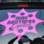 Large Mad Brothers Cycles sticker on back window of car