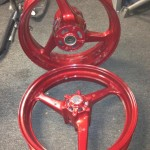 Red powder coated wheels after dried