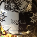 Closeup of motocross helmet with Mad Brothers Cycles logo